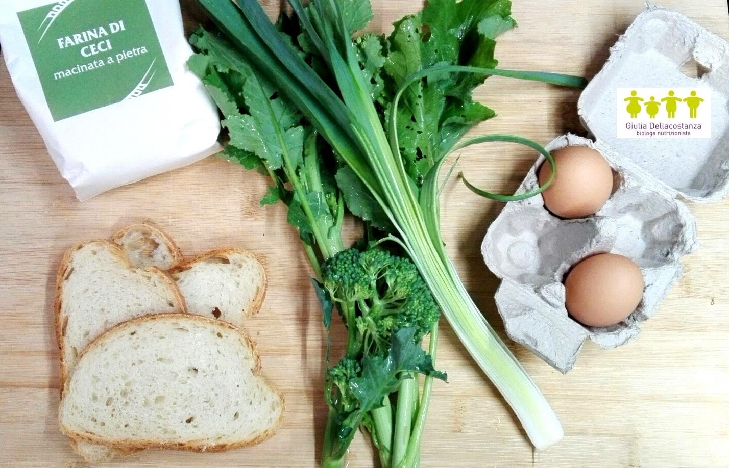 Ingredienti per fare la frittata con le verdure: uova fresche, fette di pane raffermo, broccoli, porro, cime di rapa.